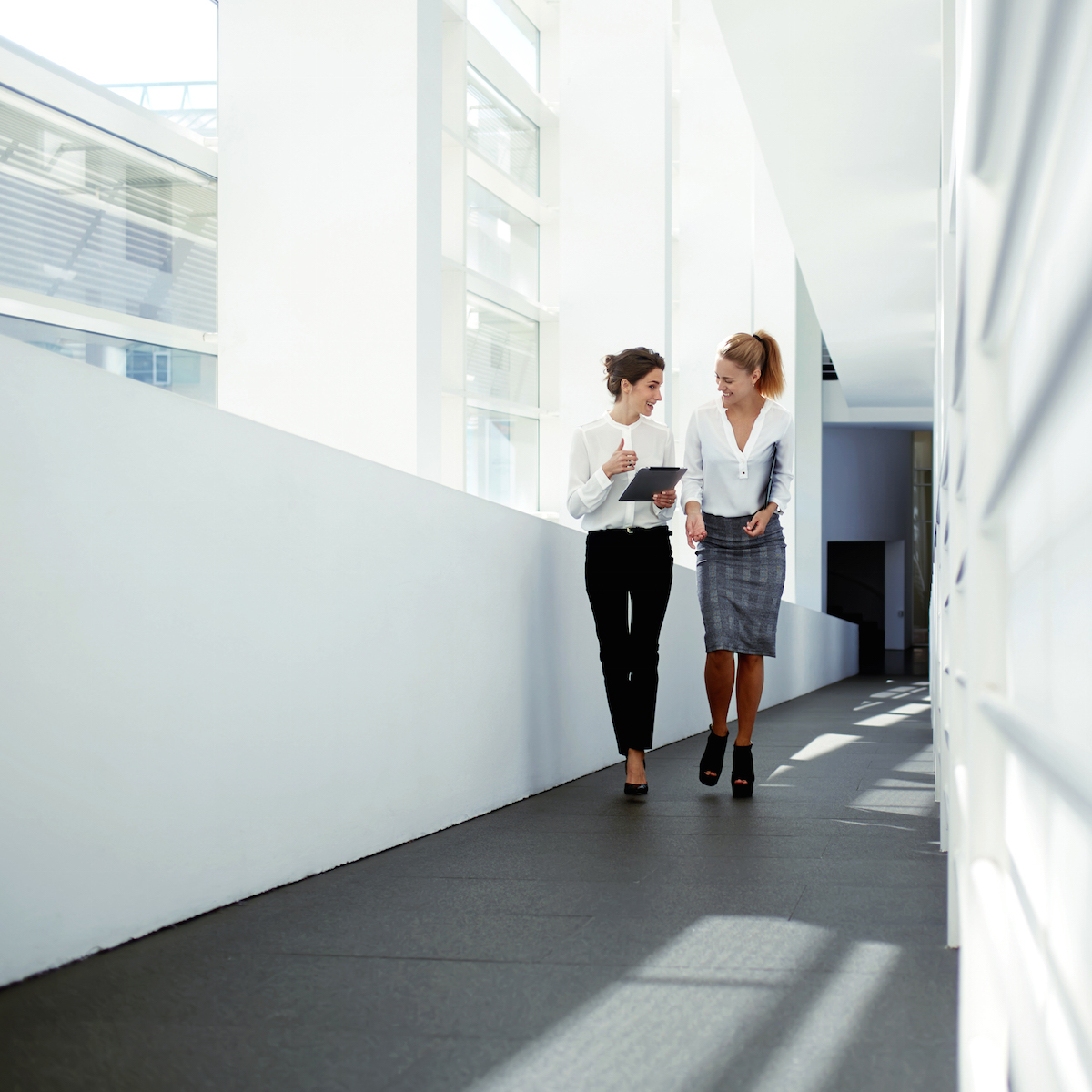 Career women walking down the corridor in a London office